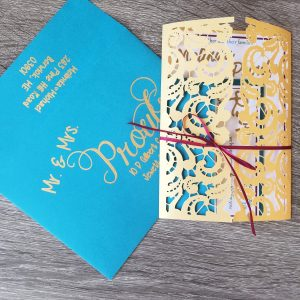 Wedding Invitation with Gold Laser Cut Gate Folds and Calligraphy Teal Teal Ivory