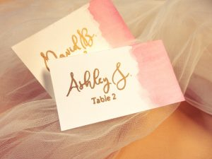 Water color pink and gold caligraphy place escort cards
