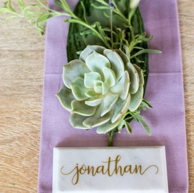 gold calligraphy marble tiles place cards escort cards
