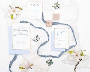 watercolor blue and gold deckled edge invitation suite