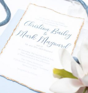 blue and gold hand deckled wedding invitation