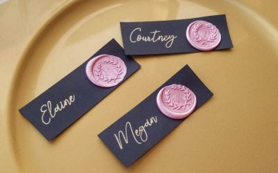 black, gold and pink calligraphy place cards with wax seal